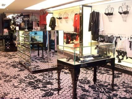 The new Agent Provocateur store at 47 East Oak Street in Chicago opened its  doors on Monday - above, pictures of the boutique's storefront and interior.